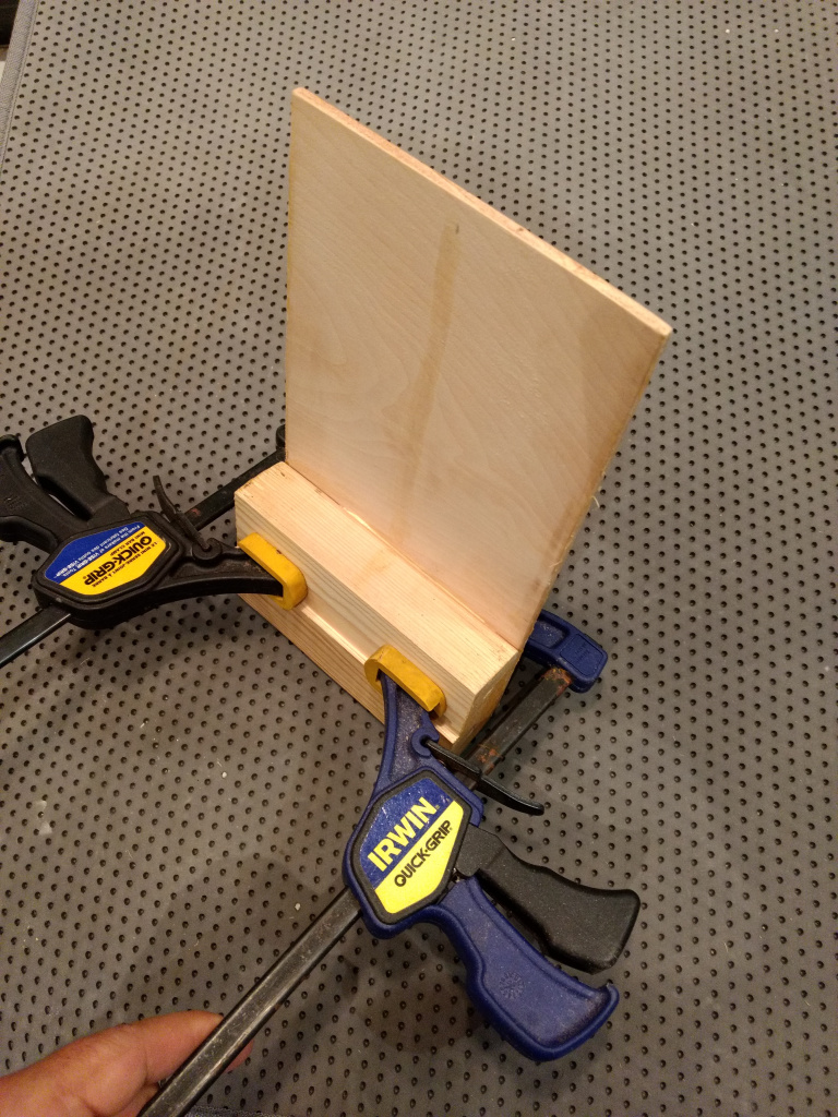 use clamps to glue the bookmark display stand together