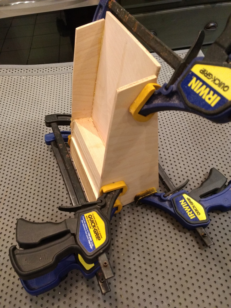 attaching the sides to the bookmark display stand