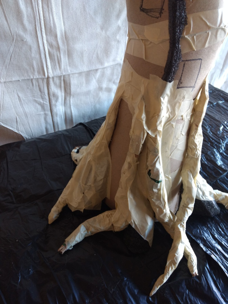 DIY model tree roots with rolled paper and foam covered with tape.