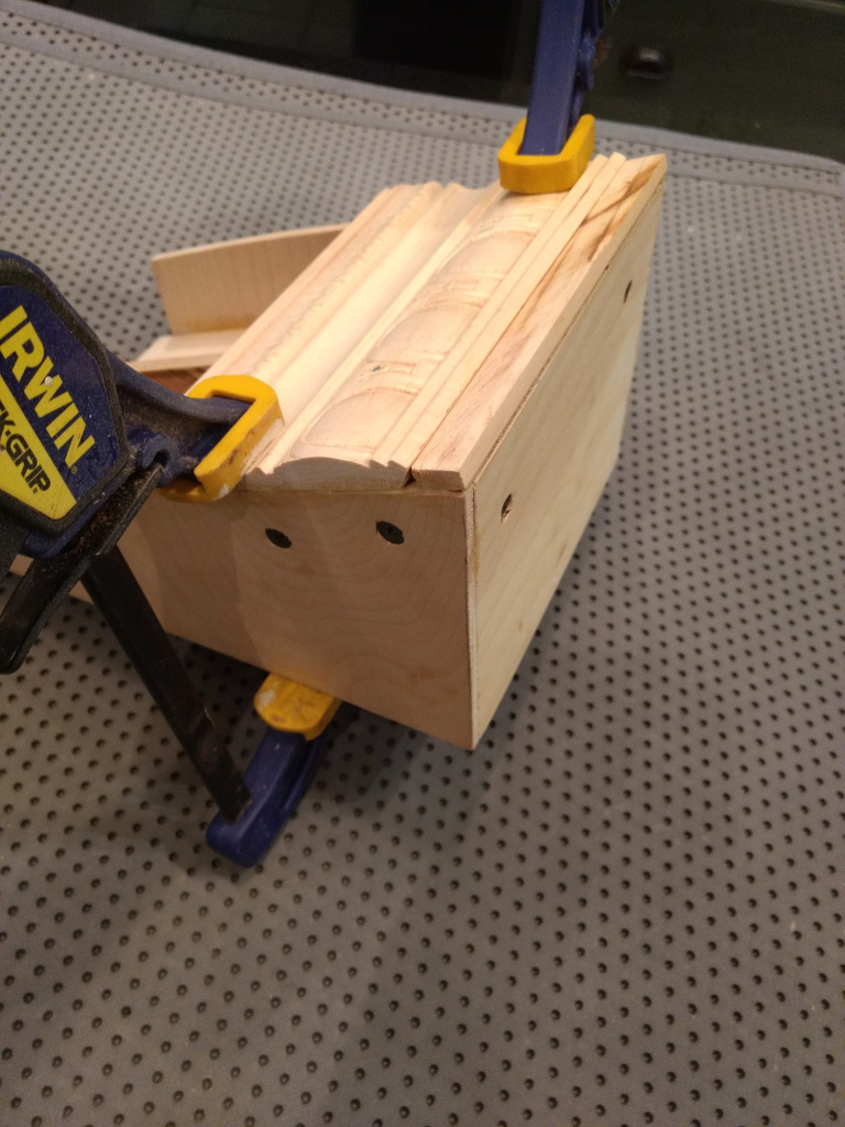 attaching the front molding to the display stand