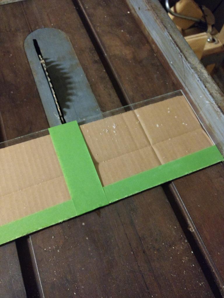 cutting the plexiglass using a saw