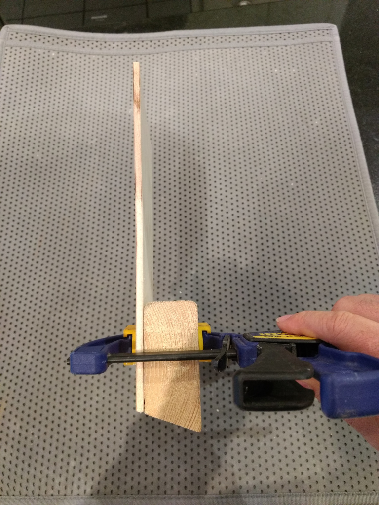gluing the parts together for the bookmark display stand